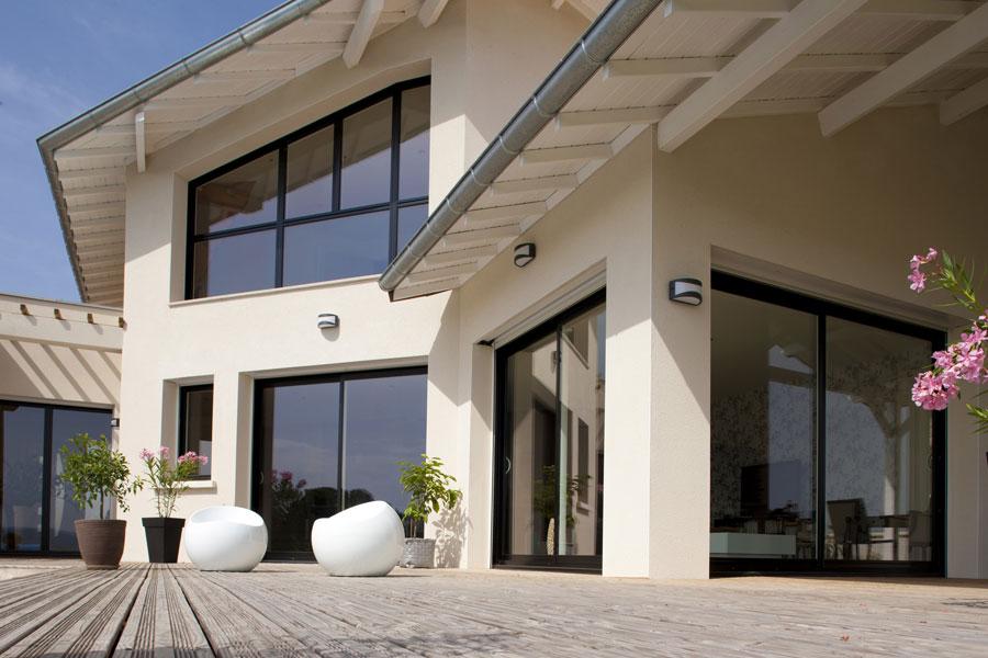 les baies vitr es coulissantes sun concept. Black Bedroom Furniture Sets. Home Design Ideas